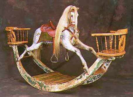 Aged replica of an F.H.Ayres rocking horse on bow with chairs.This rocking horse is available with or without chairs    With aged leather tan tack, side-saddle pommel, 'old green' saddle blanket, light mane and tail on an aged bow