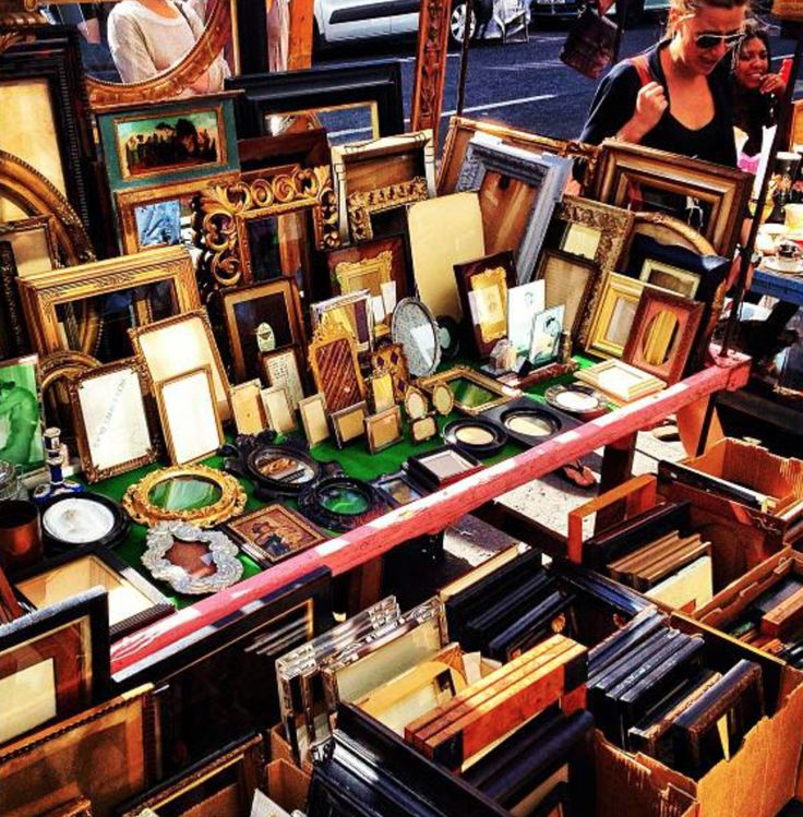 Antique Frames stall in Portobello Market where the antiques section is running from Westbourne Grove to Elgin Cresent.