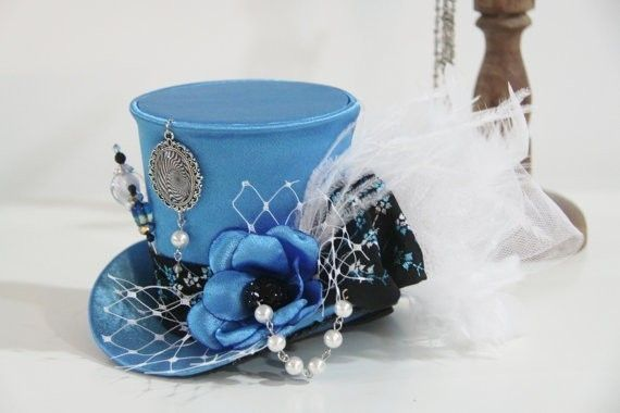 $38 current bid on eBay.  Steampunk Mini Top Hat Alice in Wonderland Bridal Fascinator Tea Party Veil | eBay