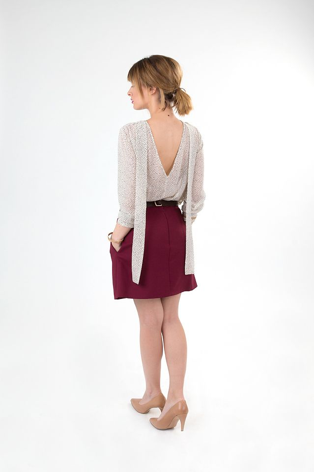 White chiffon shirt with dark linen short skirt with pockets.