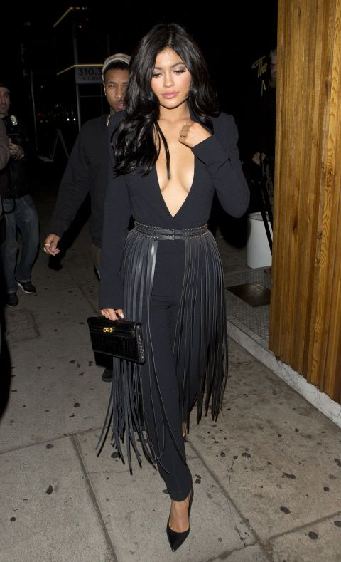 Kylie Jenner. The star made her plunging black jumpsuit even more interesting by adding a fringed, leather belt/skirt thing - and we love it.
