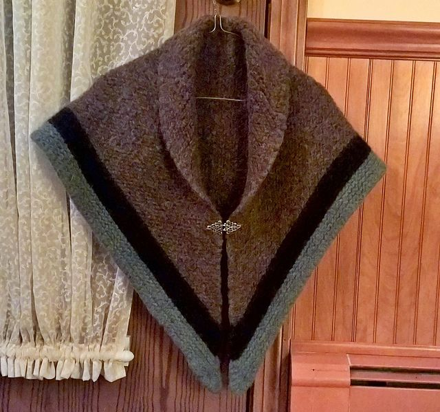 "This shawl was inspired by the one that Claire Randall wears in the Outlander TV series on Starz. (Saturdays, 9 PM) The original shawl was made in three colors. I chose to do mine with only two. This shawl isn't an exact replica, but inspired by, Or rather my ""take"" on it."