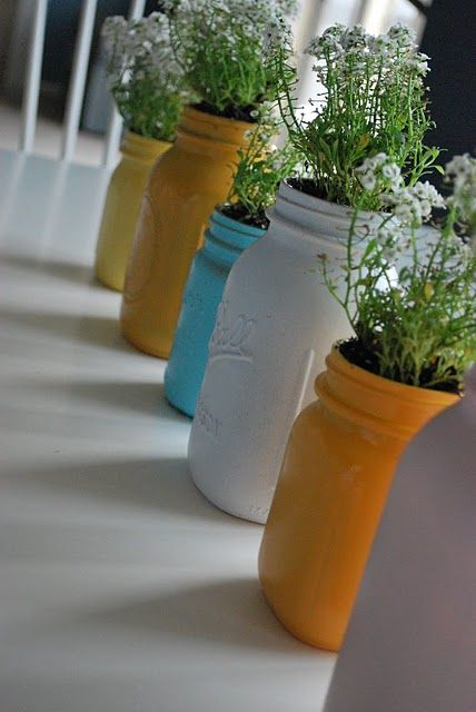 Spray painted mason jars... so adorable.  I could see a little row of these indoors filled with houseplants.  Or perhaps on my picnic table with asyllum like she has.