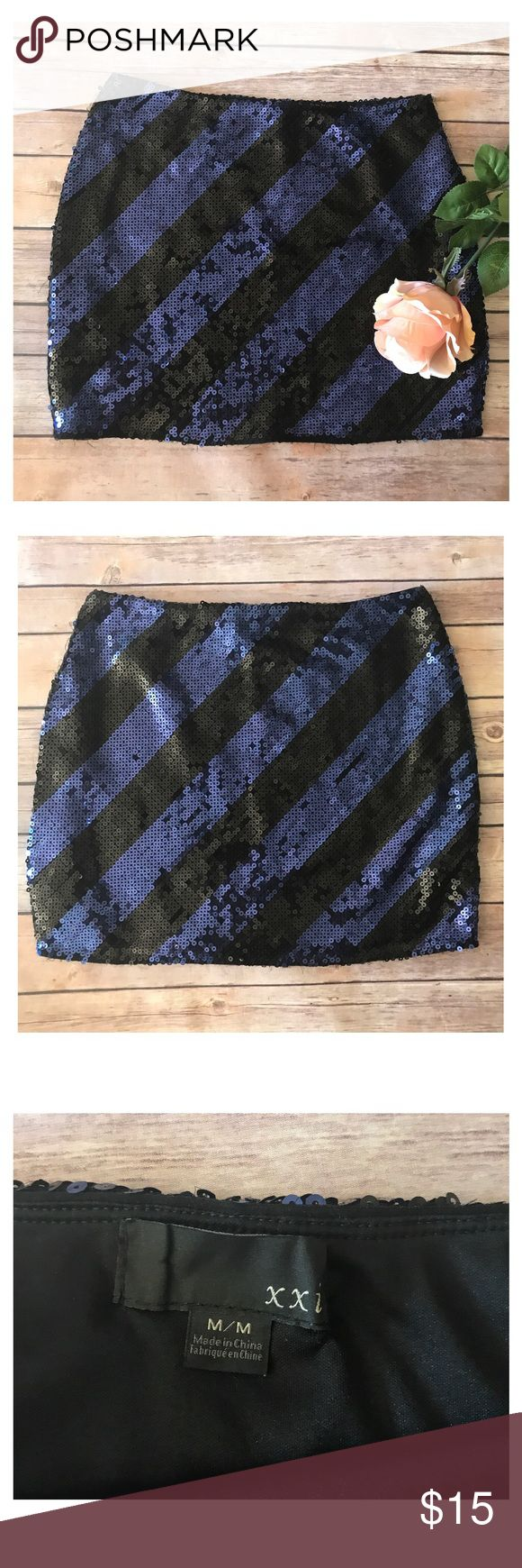 XXI Blue & Blue Striped Sequin Skirt Blue and black Sequin skirt! It's a mini skirt but has a lot of stretch to it. Worn once with a black thin sweater and looked great in the fall! Let me know if you have any questions prior to purchase! 🤗💕 XXI Skirts Mini