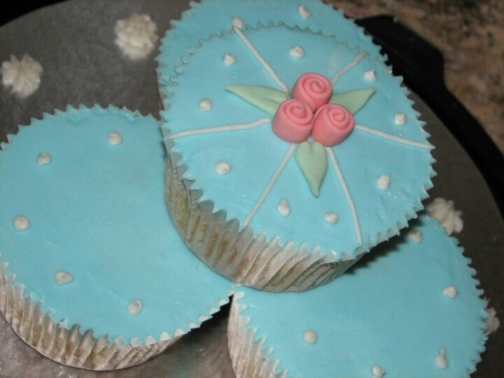 Giant muffin size Cupcakes with butter cream frosting and fondant rose and leave detail