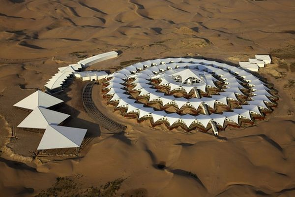 The Lotus Hotel is prefabricated net zero hotel under construction in China's Xiangshawan desert that requires no water, no concrete and no foundation.