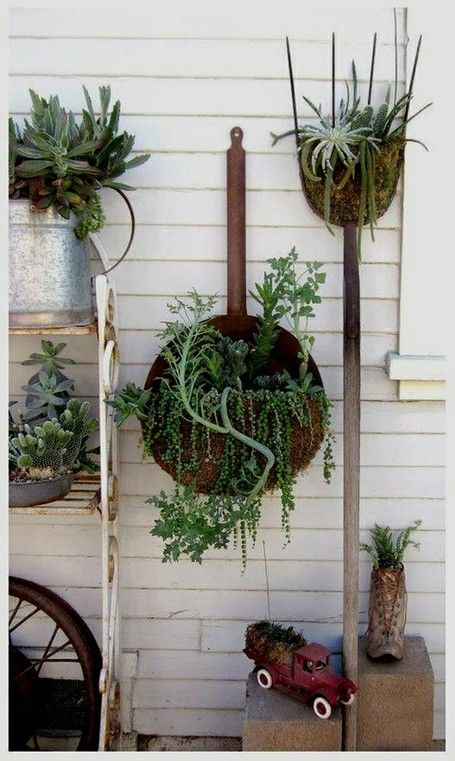 Vintage cottage style outdoor succulent garden  using repurposed gardening tools rakes and old toys as containers; upcycle, recycle, salvage, diy, repurpose!  For ideas and goods shop at Estate ReSale  ReDesign, Bonita Springs, FL