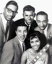 "The Miracles are an American rhythm and blues group, notable as the first successful act for Berry Gordy's Motown Record Corporation. Their 1960 song, ""Shop Around"" became Motown's first million-selling hit record, and the group went on to become one of Motown's ""signature acts"" of the 1960s, and one of the most important and influential groups in music history. Formed in 1955 by William ""Smokey"" Robinson, Warren ""Pete"" Moore and Ronald ""Ronnie"" White."