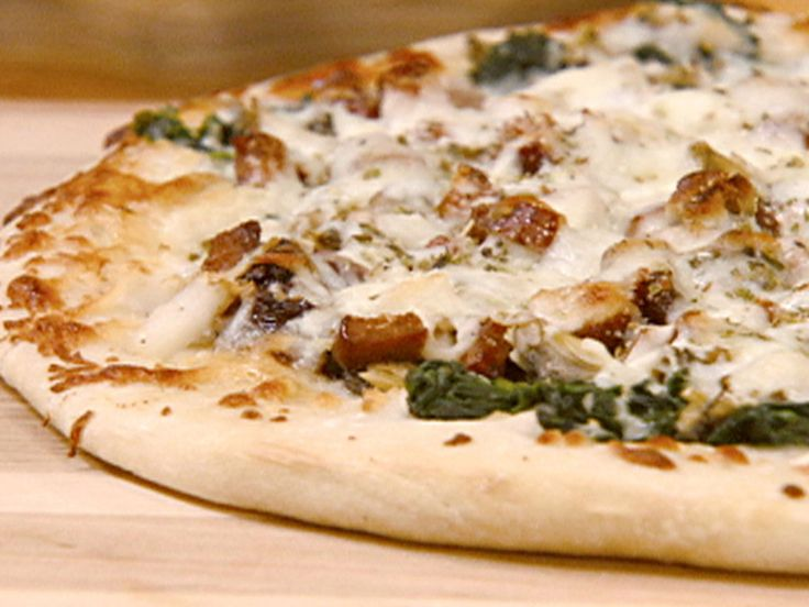 Vongole Pizza with Andouille, Clams and Scallops recipe from Robin Miller via Food Network