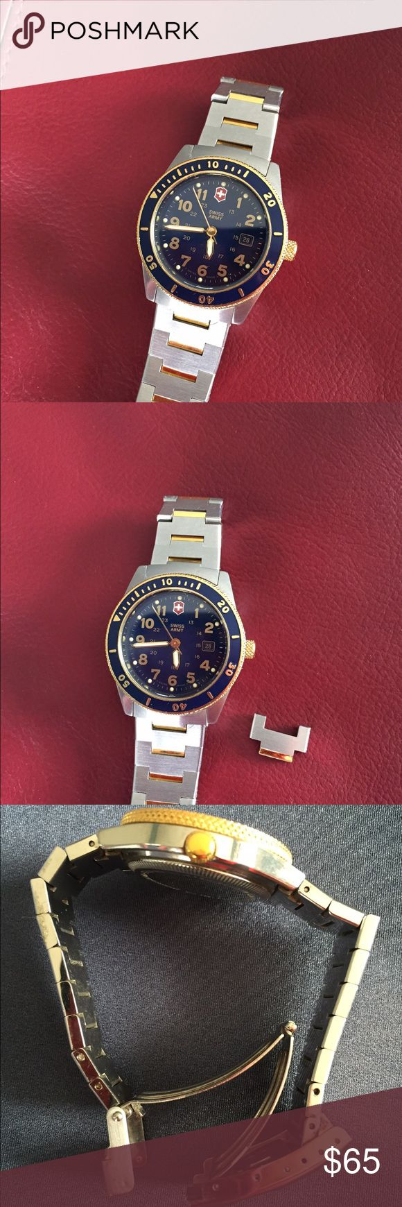 Swiss Army watch Stainless steel case and deployment band with gold accent links. Fits small wrist, extra link available. Date display and moveable bezel. Shows some wear, please see photos. Needs battery. Swiss Army Accessories Watches