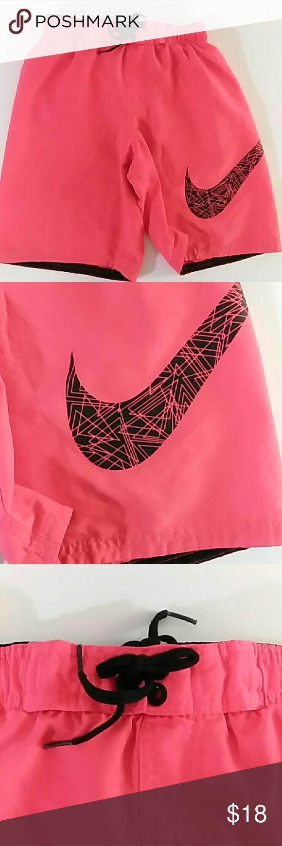 Red Nike swim trunks with big logo Gently used red Nike swim trunks with big logo size large. Nike Swim Swim Trunks