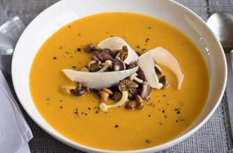 Gordon Ramsey's roasted pumpkin soup with wild mushrooms and parmesan. Just watched him cook this on his Christmas special for 2011. Mouthwatering!