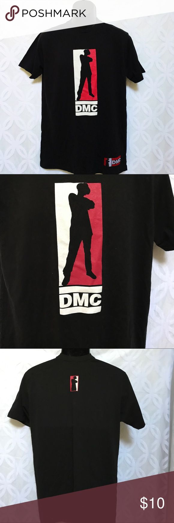 "Run D.M.C. Darryl McDaniels Black Tee Run D.M.C. Darryl McDaniels Black Tee NWOT.                               Measurements Laying Flat Size 🔹L Armpit to Armpit 🔹22"" Shoulder to Hem 🔹31"" Bundle to Save 🤓 Sorry NO outside transactions 🚫 NO trades 🚫 Reasonable Offers welcomed 👍 NO Low balling 👎 NO modeling 👎 NO Holds👎 All items from a pet 😼and Smoke Free Home  Happy Poshing 🤗 DMC Shirts Tees - Short Sleeve"