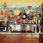 The pots, pans, and utensils of a colorful Los Angeles home are hung up when they aren't needed as kitchenware. Photo byBryce Duffy.