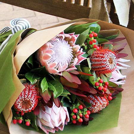 """Buy """"Native Bouquet"""" for $88.95. The Native Australian Flower Bouquet Is A Lovely Way Of Expressing Your Thoughts With Some Of The Most Botanical Australian Native Flowers. The Native Flower Bouquet Features Blush Pink And Burgundy Protea, Silvery Gumnuts, And Rich Red Leucodendren Foliage Combined Into A Long Lasting, And Quintessentially Australian Bouquet. As With All Of Our Bouquets, The Native Flower Bouquet Has Been Designed With Care By Our Professional Florist Team. To Be Guaranteed…"""