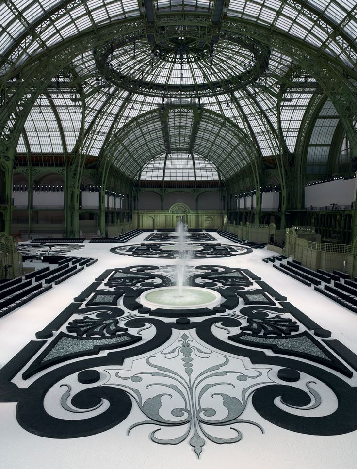 French garden under the glass ceiling of the Grand Palais - Chanel fashion show set S/S RTW 2011