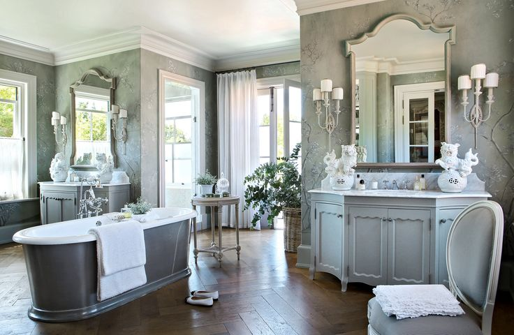 Classic large bathroom with separate vanities and free standing tub
