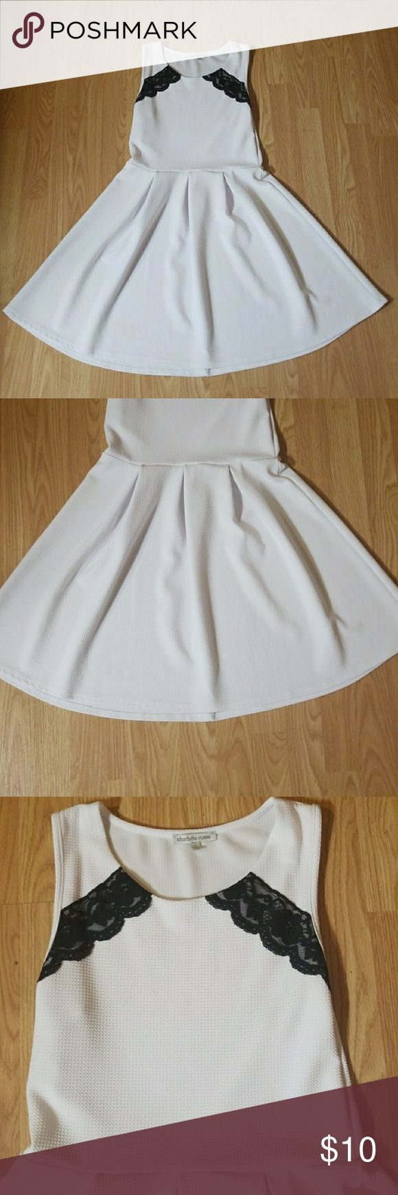 White short pleated/skater dress White dress with pleated skirt and black lace accents on the collar bone area. Super comfortable and airy to wear in the summer time. Charlotte Russe Dresses Mini