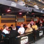 Outdoor eating area of Egon Restaurant with sidewalk barriers by New York City Signs & Awnings