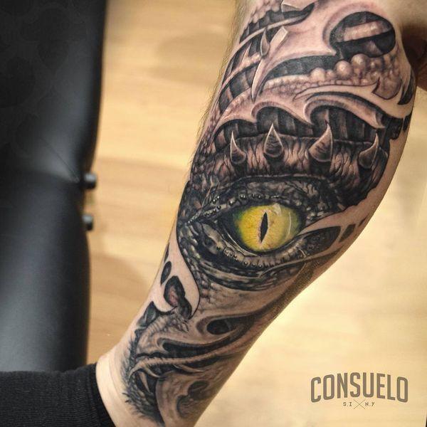 The bio-organic tattoo of dragon eye on the leg
