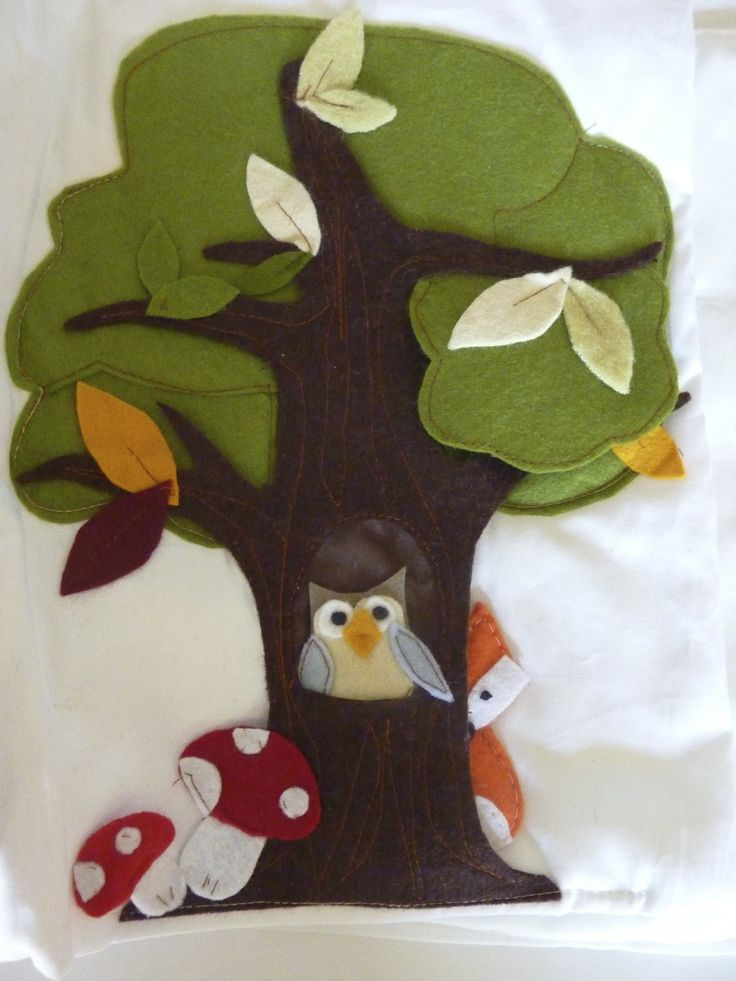 the tree with an owl and a hidden fox.