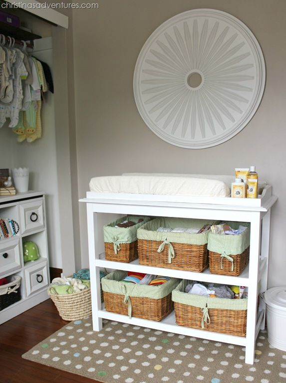 Love the organisation of this space: baskets for wipes nappies etc, mat under changing table, basket of cloth nappies on the left and pail for dirty nappies on the right.