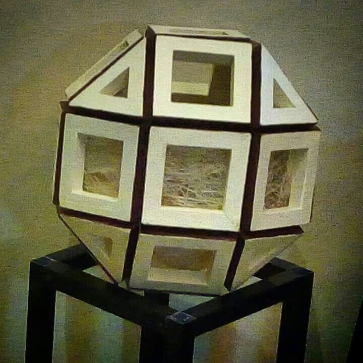 """FROM PAPER TO WOOD  Polyhedron # 13 - RHOMBICUBOCTAHEDRON  Designed by Leo R. Natividad for Lights & Folds Handicraft  Fabricated by Allan Aguinaldo  Using 3/4""""×3/4""""×4.5"""" Softwood 8   Triangles 18 Squares 26 Surfaces  48 Apexes  72 Edges  Circumference - 41"""" (104.14 cm) Diameter - 13.05"""" (33 cm)  Price - Php 4,172.65  #from_paper_to_wood #only_in_the_world #origamipilipinas #lights_and_folds_handicraft #only_in_the_Philippines #origami_inspired_wooden_polyhedron"""