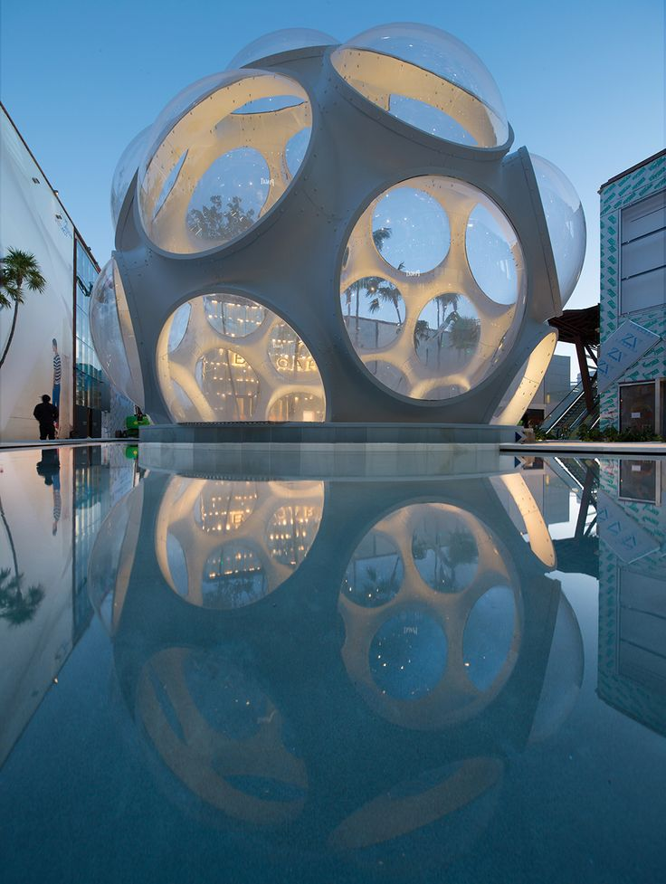 One of the world's most elegant entries - through a re-creation of the Fly's Eye Dome. Palm Court, Miami Design District. Master Architect: SB Architects. Photograph by Robin Hill.
