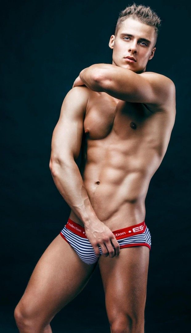 Den Wok sports a trendy black and white ES Collection Sailor brief with vibrant red trim and a nice sized waistband in this photo shoot with Ruslan Elquest. #Fashion #Underwear