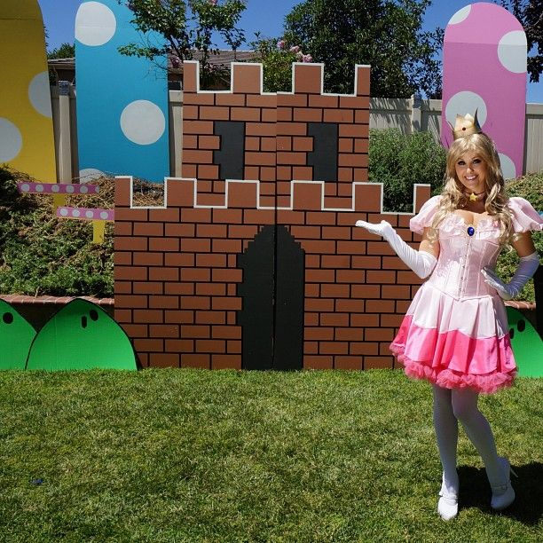 Princess Peach at a backyard Mario themed party.