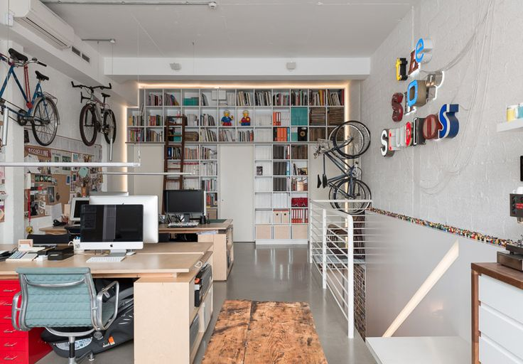 Desks - two people per side, facing each other, square with storage, pops of color Bike storage! Cube library (against wall of The Pit)
