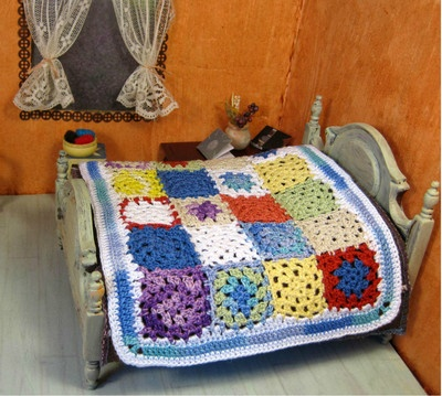 This miniature crochet patchwork bedspread is a celebration of the granny square. Sold, but visit my website Pugcentric Pursuits.