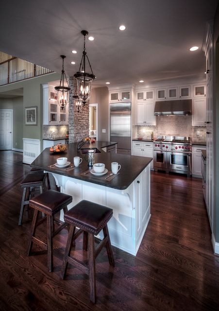 love the dark floors and white cabinets