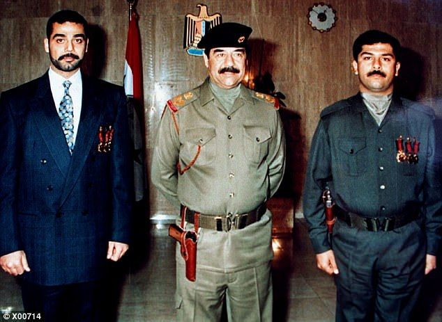 GOLD MEDAL BRANDING: President Saddam Hussein (C) is flanked by his two sons Uday (L) and ...