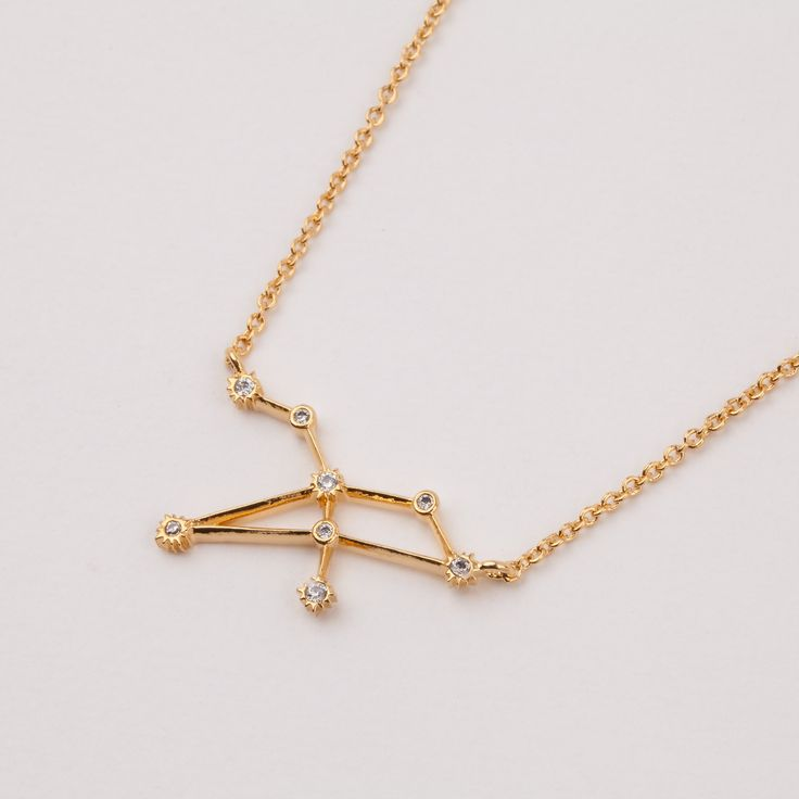 """A dainty and delicate token ofeach astrological sign, this necklace is the perfect gift for loved ones. Gift this to the Leo in your life, ruled by the planet of power.Leo birthdays:July 23 to August 22Brass base14K gold platedEight1.5mm cz stones2 cm widthMeasures 16"""" in length with 2"""" exten..."""