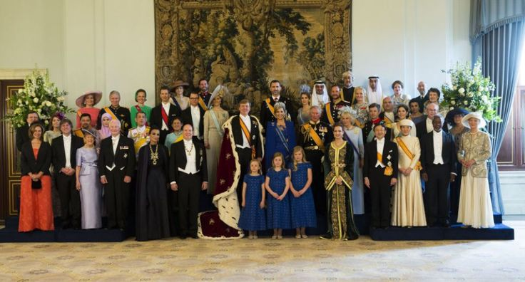 Marking the moment: King Willem-Alexander and Queen Maxima and their daughters pose flanked by members of the royal household, heads of state and government and special guests during the photo-call