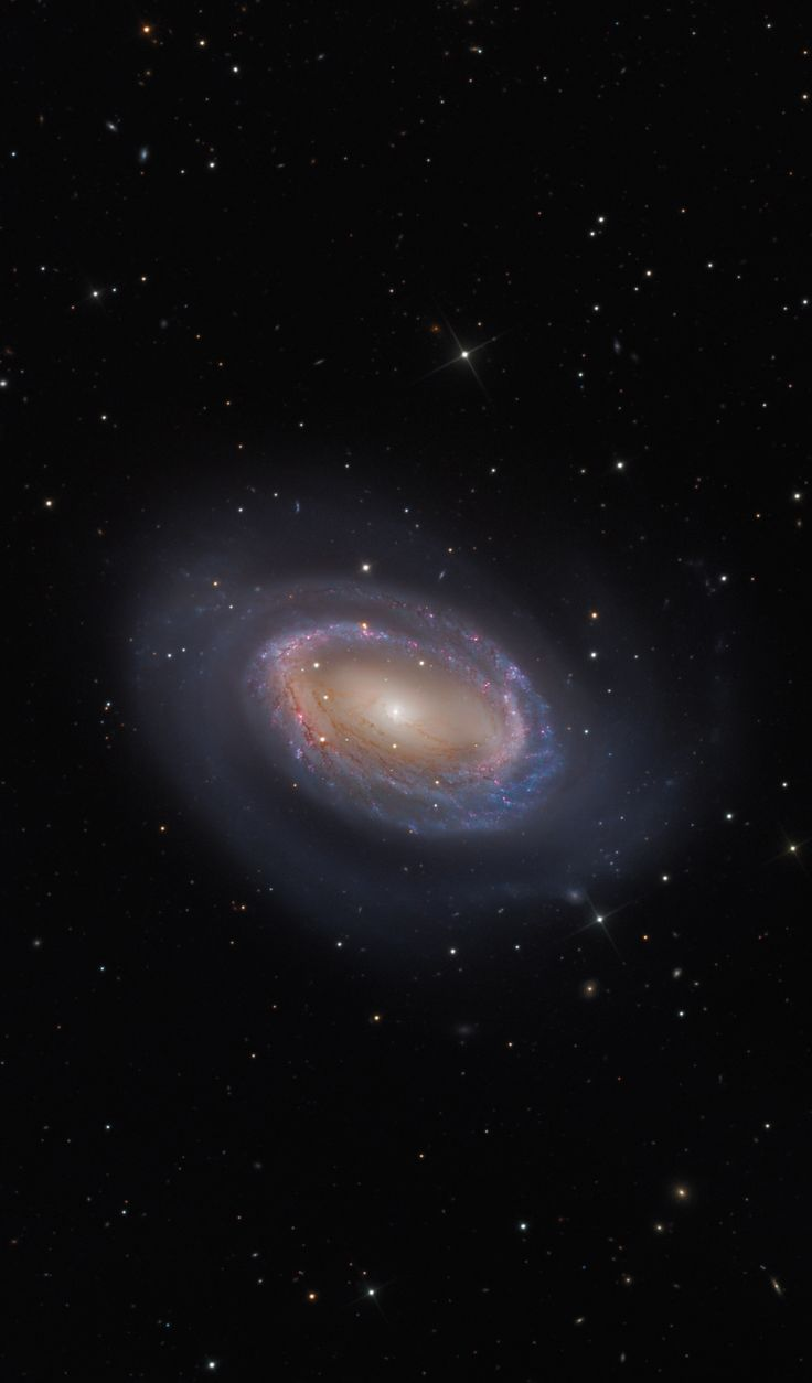 While most spiral galaxies, including our own Milky Way, have two or more spiral arms, NGC 4725 has only one. In this sharp color composite image, the arm, solo spira mirabilis, seems to wind from a prominent ring of bluish, newborn star clusters and red tinted star forming regions. Astronomers refer to NGC 4725, located 41 million light-years away in the constellation Coma Berenices, as a ringed barred spiral galaxy because a prominent ring of stars encircles a bar of stars at its center.