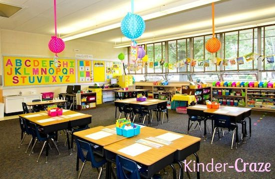 a FUN brightly colored classroom with polka dot lanterns and matching table bins