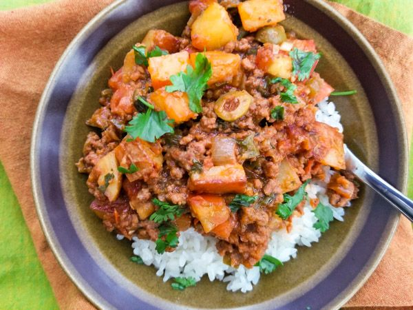 This Authentic Mexican Picadillo Recipe is the most delicious, easy picadillo recipe. Perfect on top of white rice, filling for tacos or empanadas.