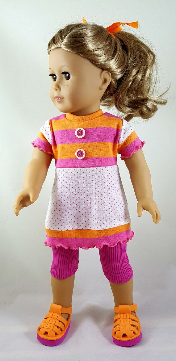 18 inch doll tunic in 100% cotton knit has pink & orange striped bodice with coordinating white & pink polka dot cotton knit skirting. It is accented with buttons on bodice and handmade ruffled edging and has back Velcro closure for easy on/off. The coordinating hot pink leggings are