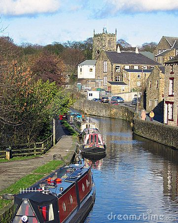 Skipton Castle, canal boat (or long boat).  Yorkshire, UK.