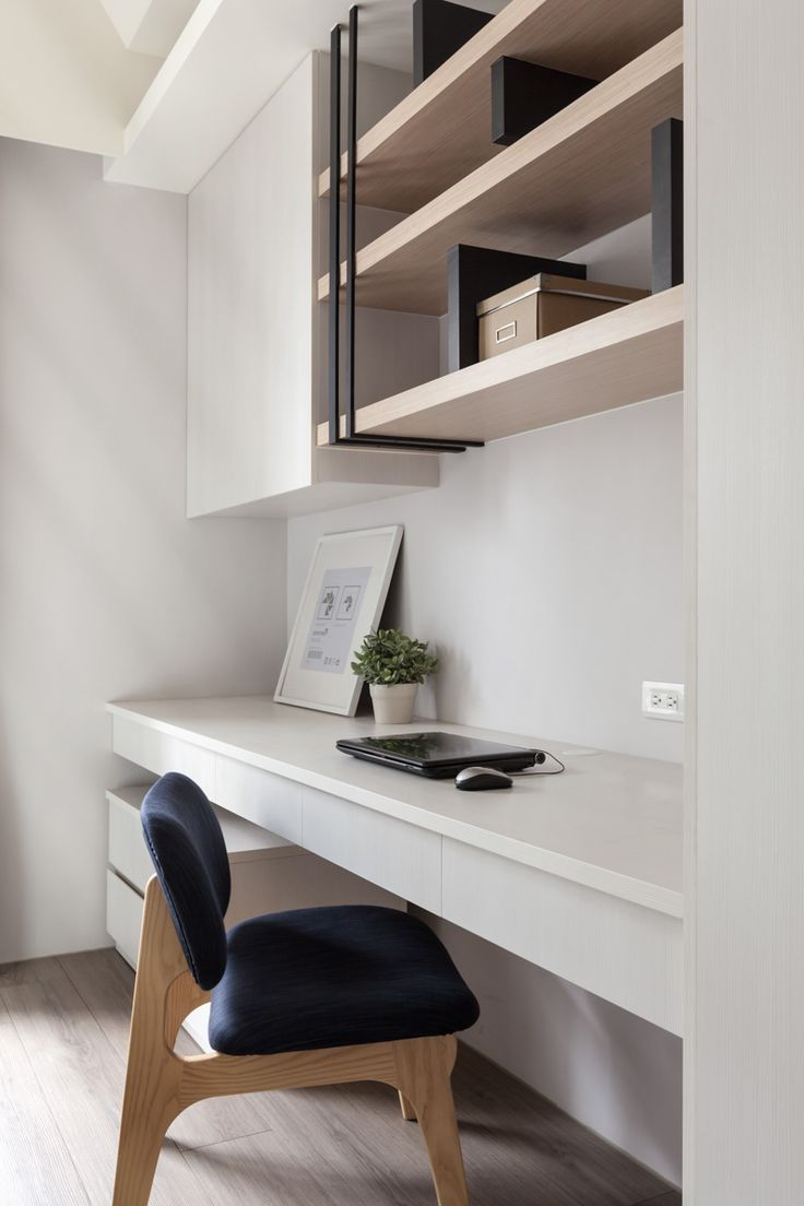 I love this simple and honest office. the floating desk, the really comfy looking chair. The mix of cupboard space and open shelving