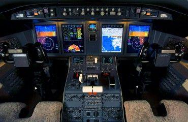 A modern glass cockpit in a C-130