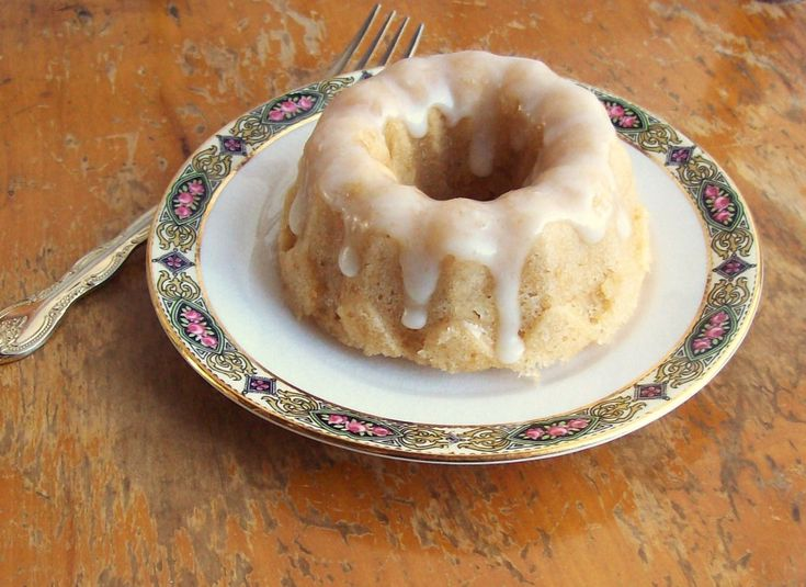 Gluten free vanilla cake made in a microwave. Used almond milk and sucanat. Cooked in a large mug.