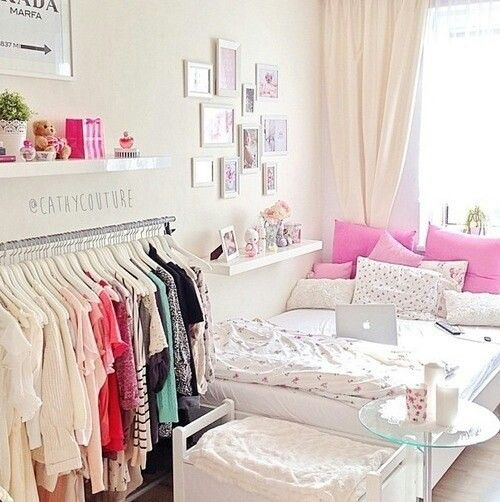For teen fashion inspired bedroom, remove doors from wardrobe to display fashion. Arrange clothes by color | Laurel & Wolf | https://www.laurelandwolf.com