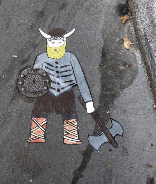 Street art: ce bouclier resiste trés bien aux crottes de chien by OaKoAk