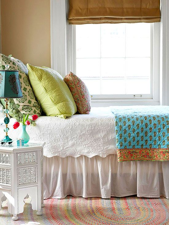 Love the white bedding and layered pops of color.