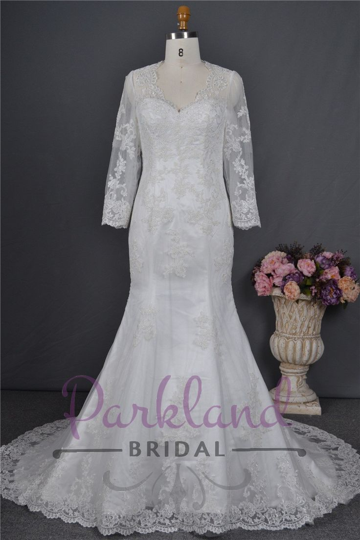 http://www.parklandbridal.co.nz/Store/tabid/4393/ProdID/33793/CatID/358/Parkland_Bridal_Gretchen.aspx  A beautiful mermaid gown with a sheer lace covered back, and 3/4 sleeves. A gorgeous high quality gown at an amazing price.