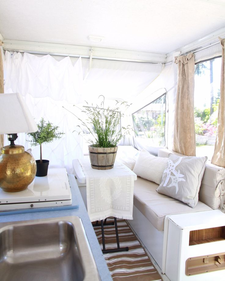Tour of an updated pop up trailer - neutral colors, beach accents with slipcovered benches. Perfect for summer right around the corner.