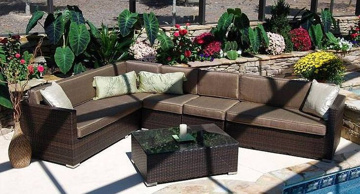 Wicker patio furniture idea for covered terrace - use lighter colored cushions with brightly colored accent pillows